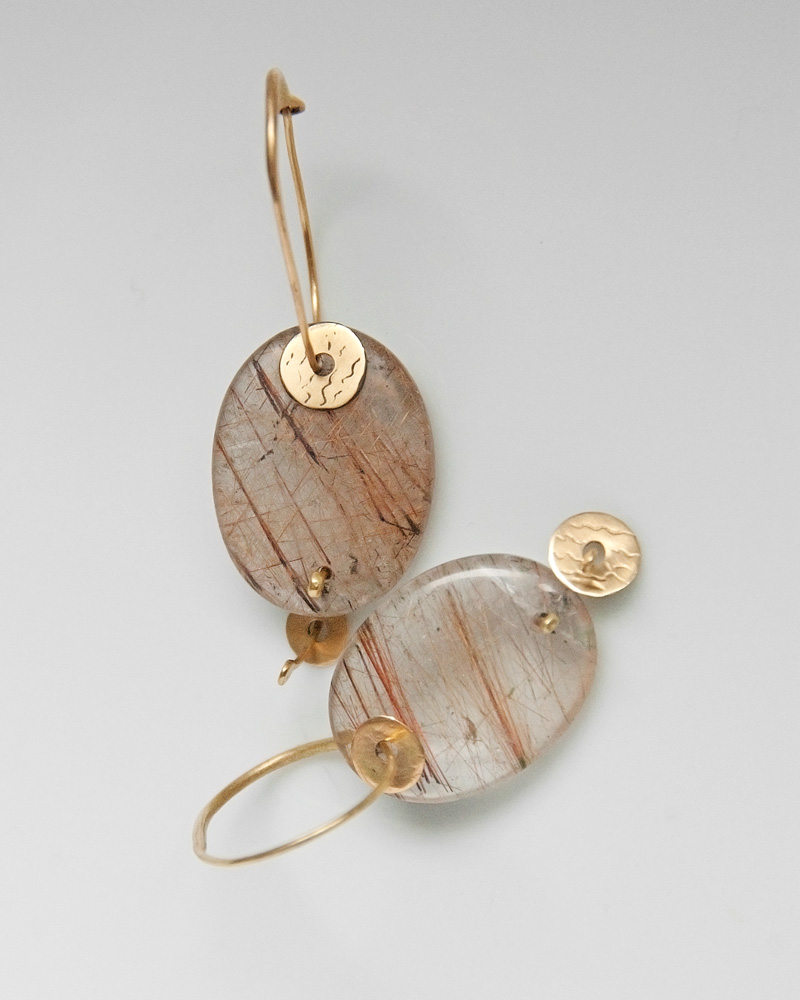 Earrings in gold and rutile quartz
